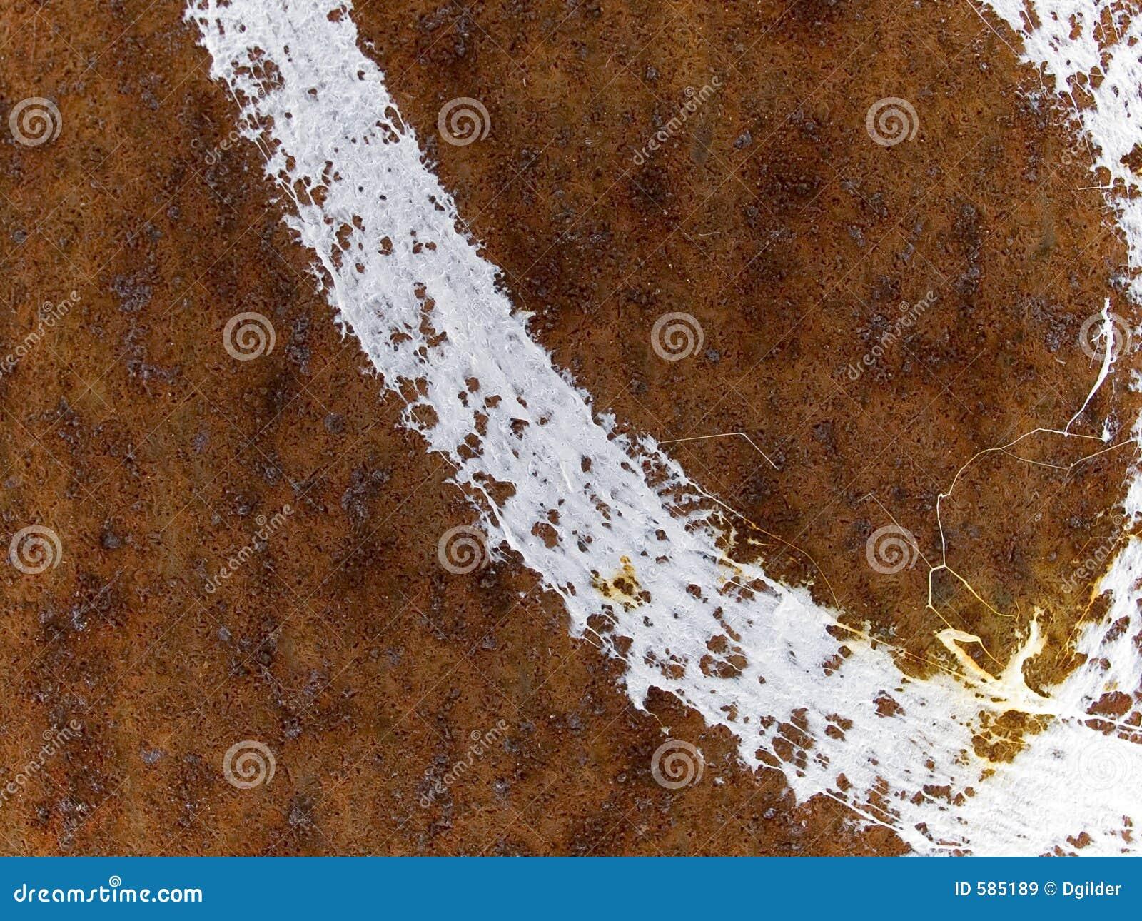 Текстура макроса - ржавая поверхность металла с полосой краски
