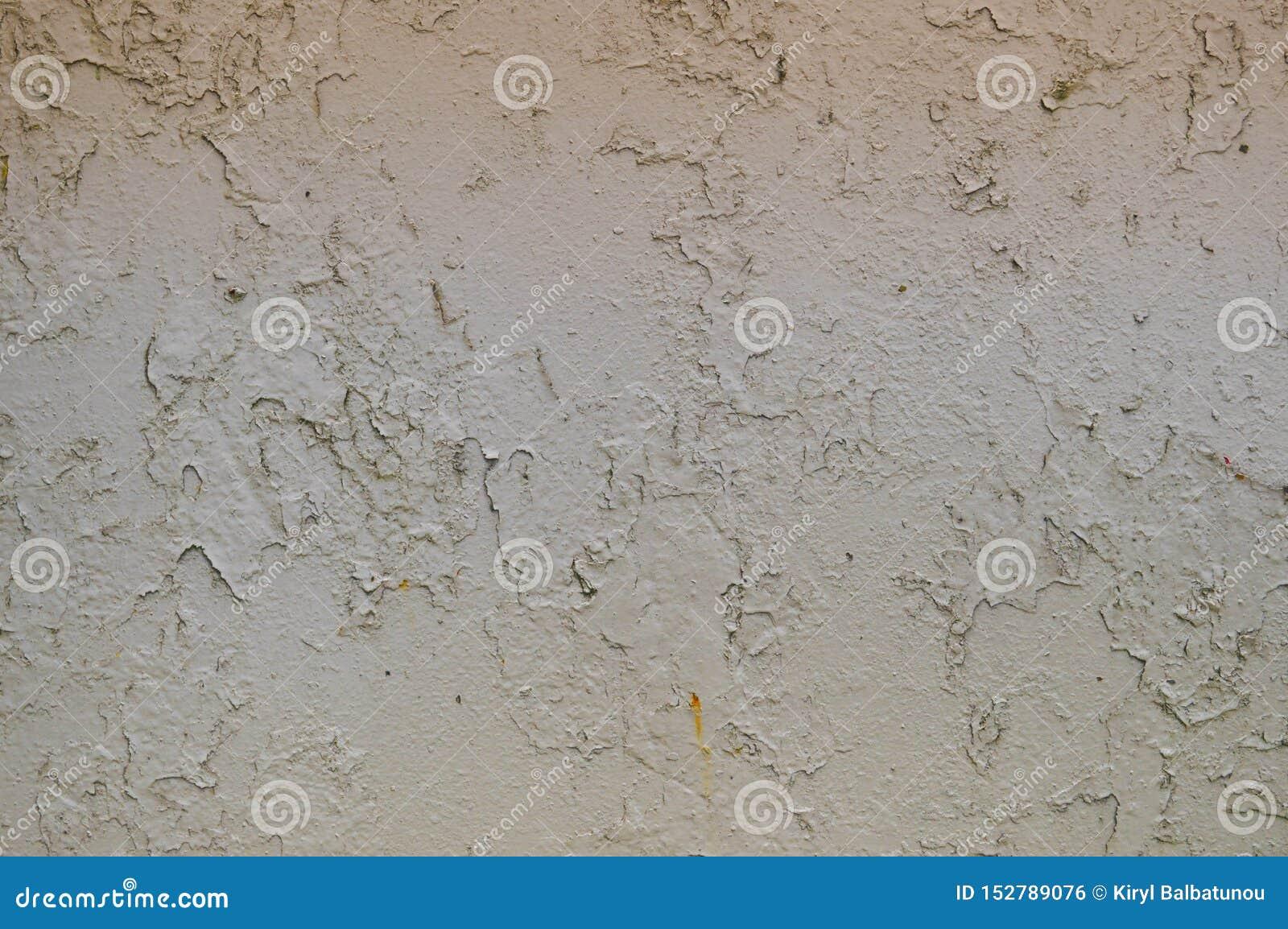 Текстура металла утюга покрасила серую слезая краску поколоченной старой поцарапанный треснула старую ржавую стену металлического