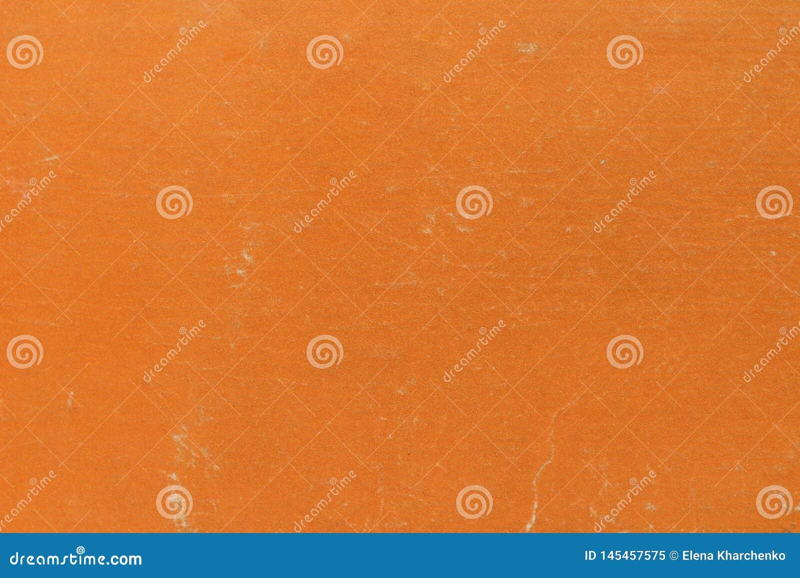 Текстура предпосылки сделана из апельсина обложки книги