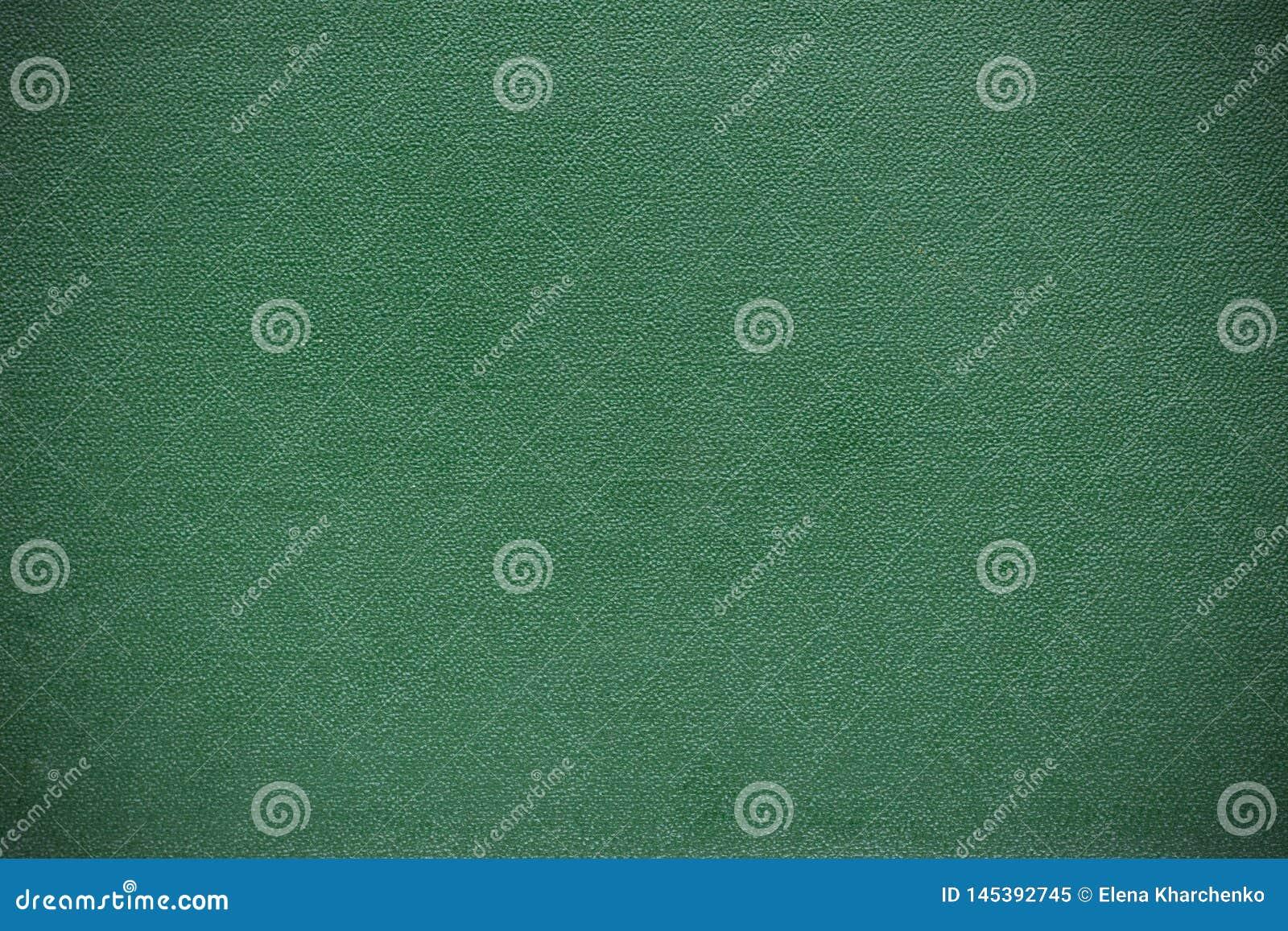 Текстура предпосылки сделана из виньетки зеленого цвета обложки книг