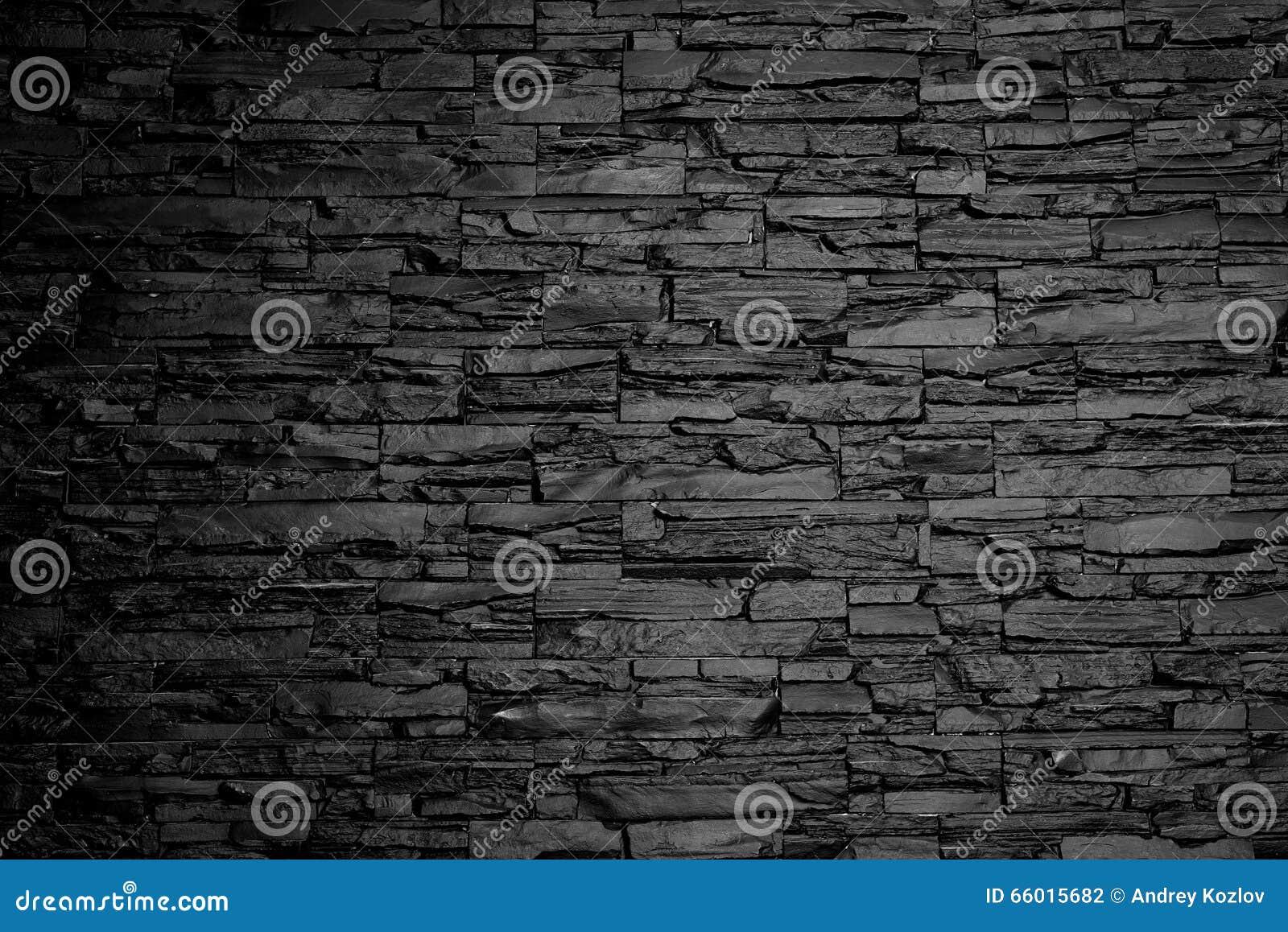 Текстура предпосылки каменной стены угля черно-белая