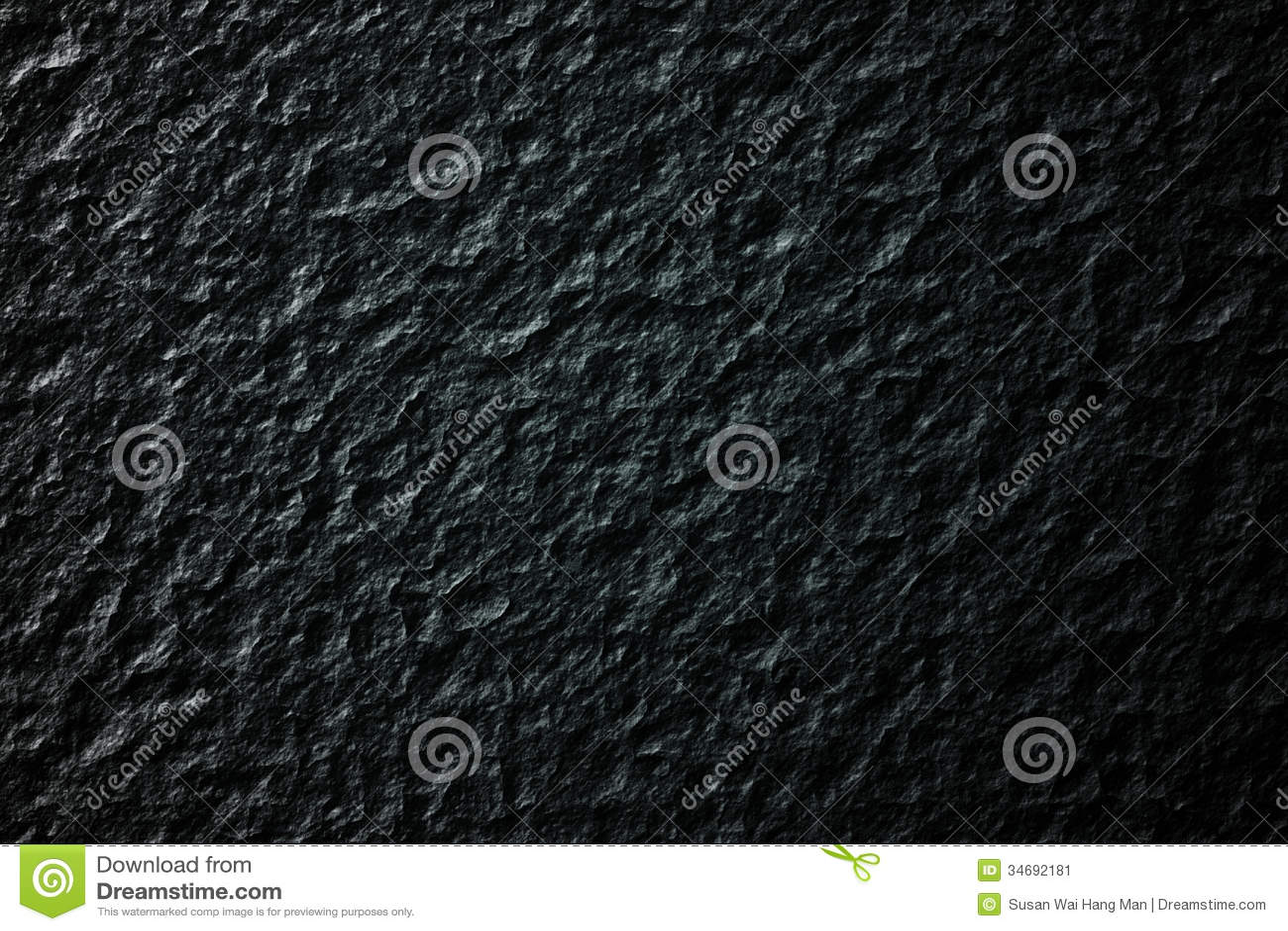 Текстура предпосылки утеса в черноте