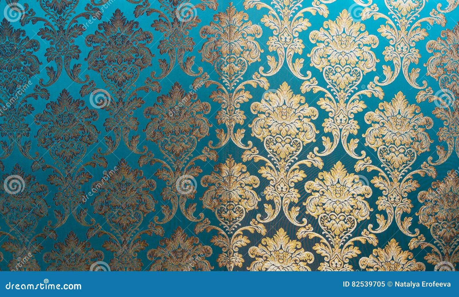 Текстура шелка с цветочным узором Китайская silk парча, красивая дорогая предпосылка ткани Em бирюзы орнамента золота
