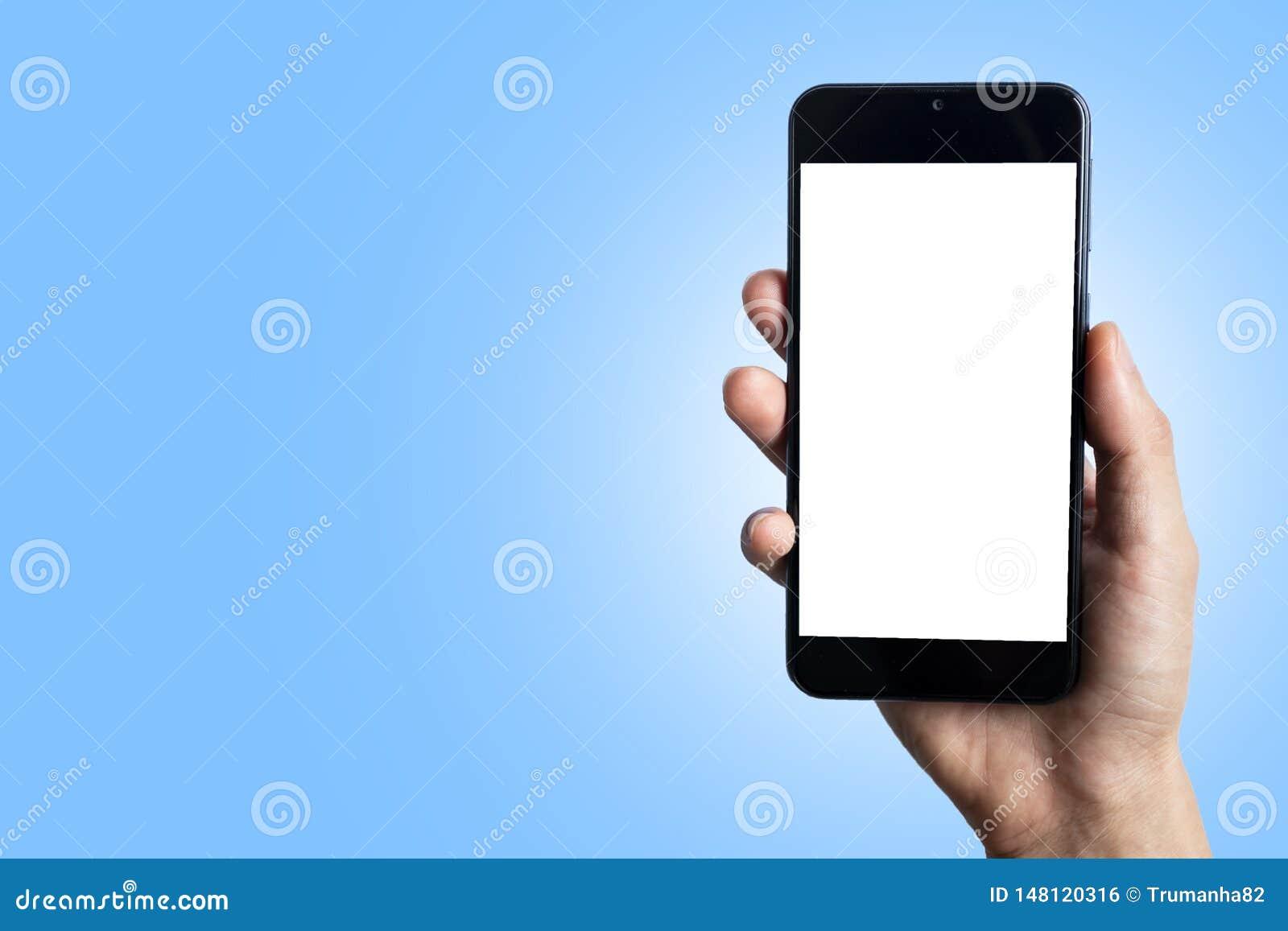 Телефон обнесенное решеткой места в суде руки в светить голубой предпосылке