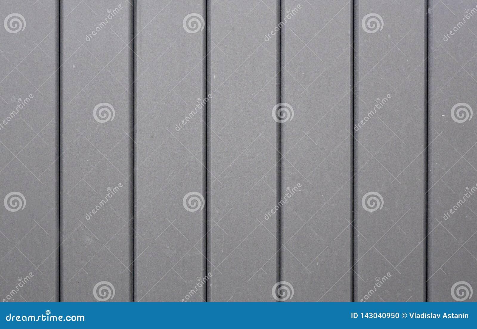 Темная стена предпосылки с нашивками к