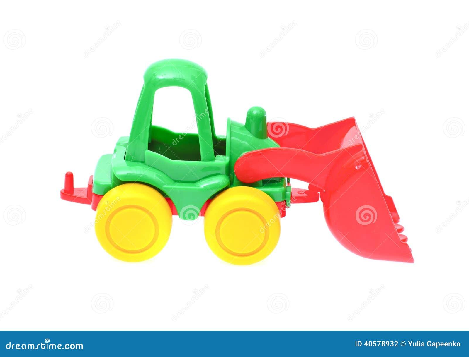 Трактор игрушки изолированный на белой предпосылке