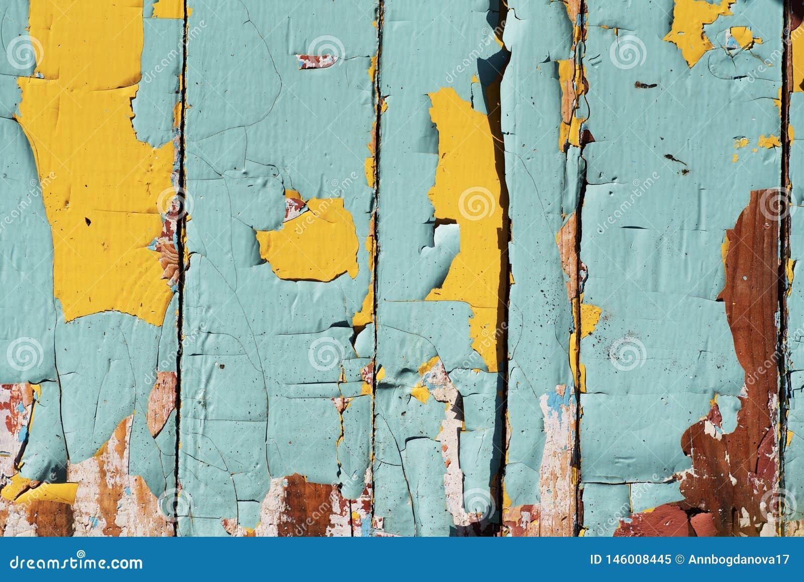 Треснутая старая краска на деревянных досках Бирюза и желтый цвет