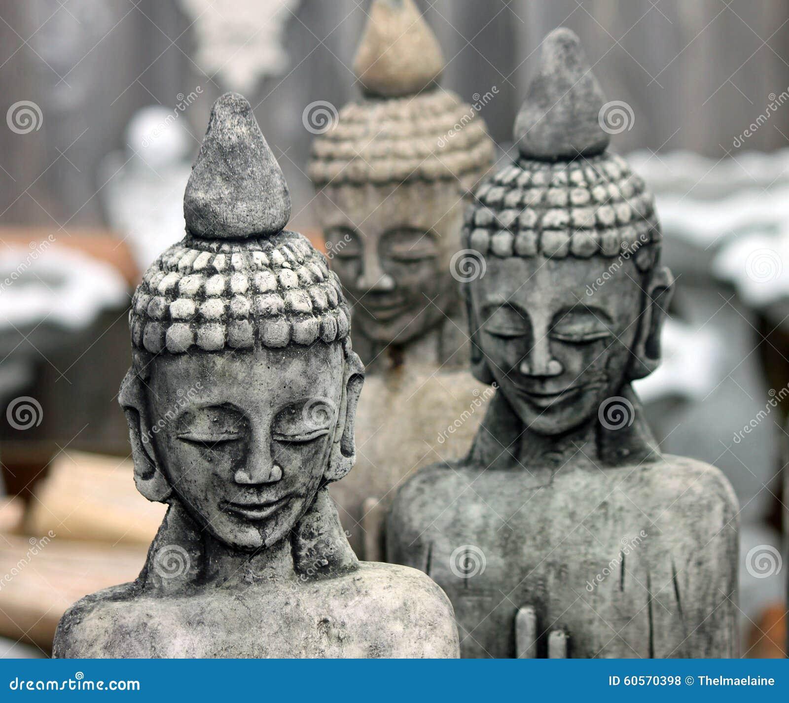 Трио каменного Buddhas