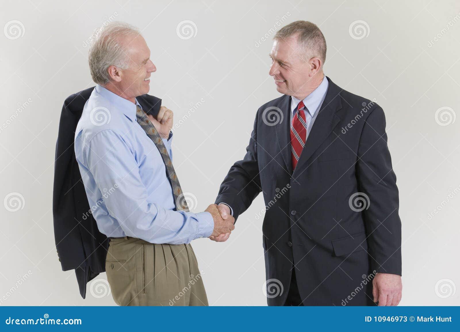 трястить рук бизнесменов