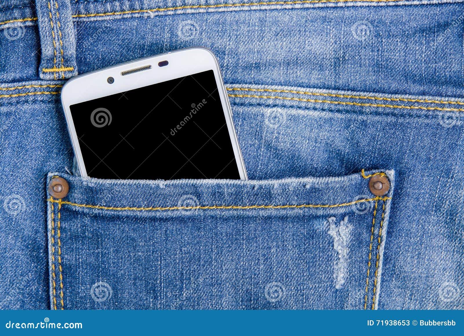 Умный телефон в задних карманных джинсах заднее карманн джинсыов предпосылки