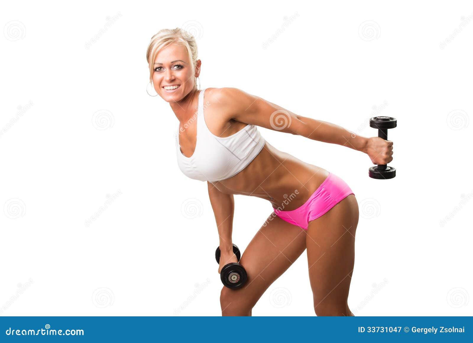 Усмехаться женщин спорта пригодности счастливый с гантелью