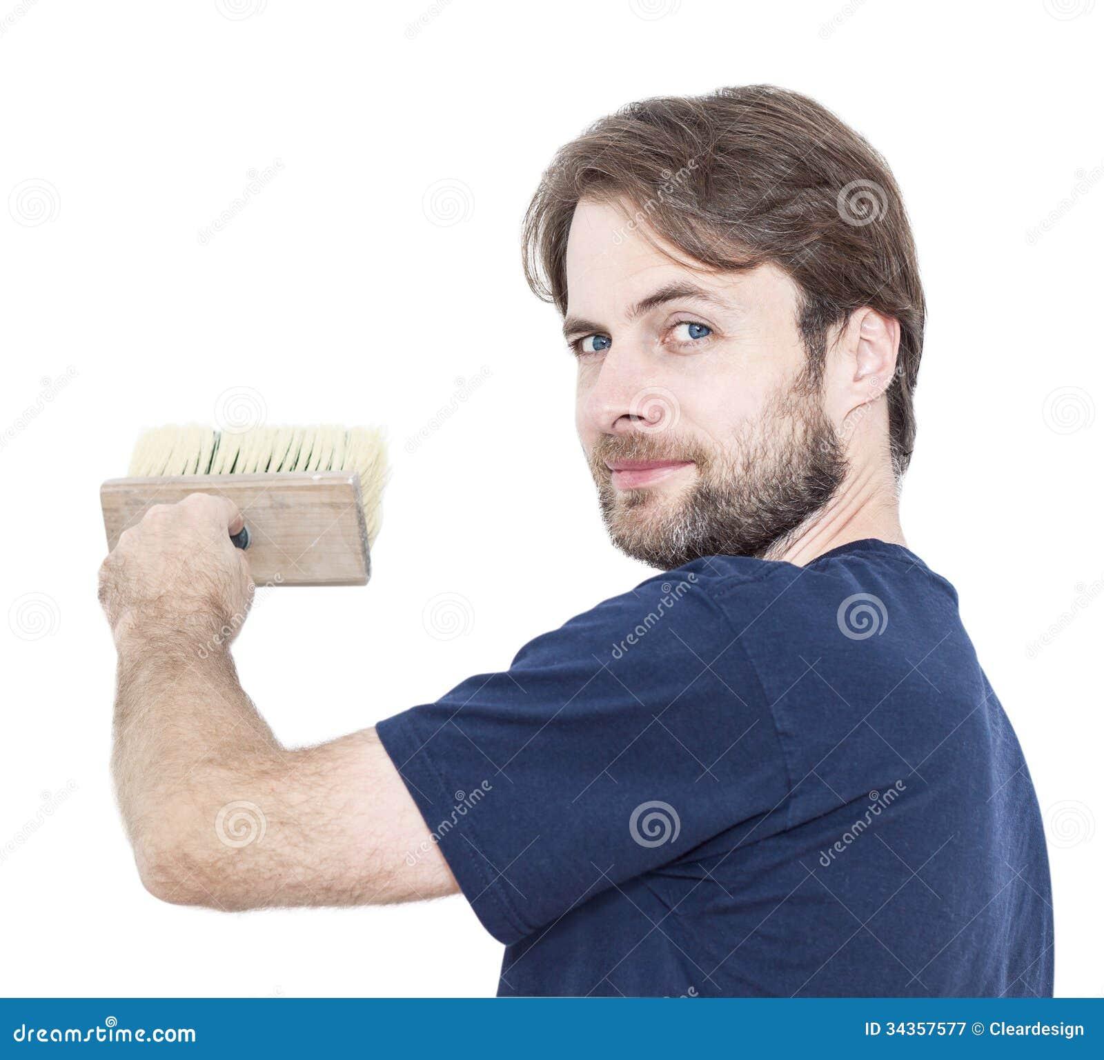 Усмехаясь человек при кисть изолированная на белизне