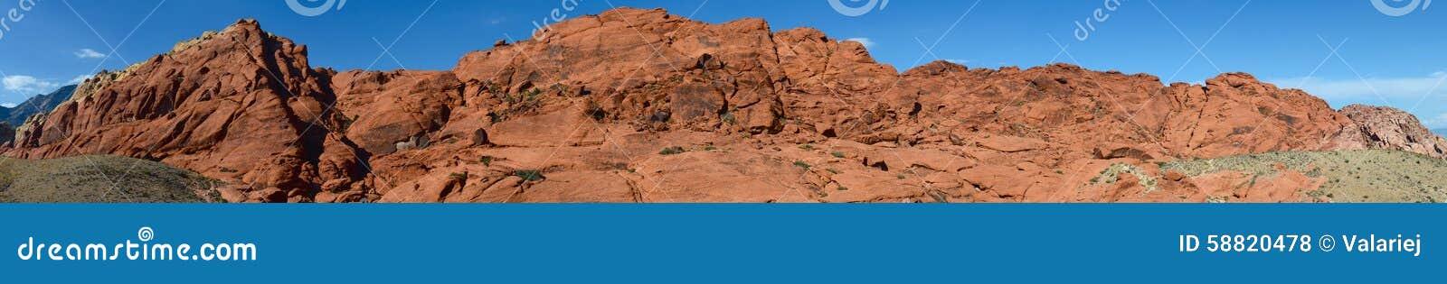 утес красного цвета панорамы каньона