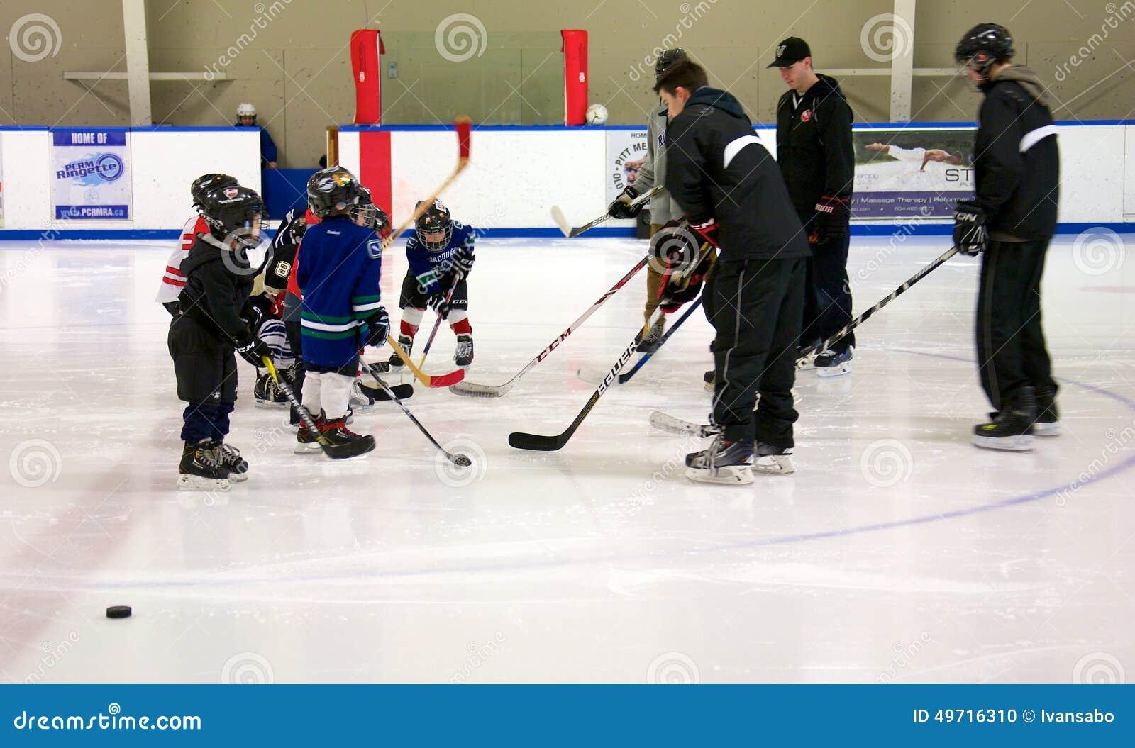 Учить сыграть хоккей