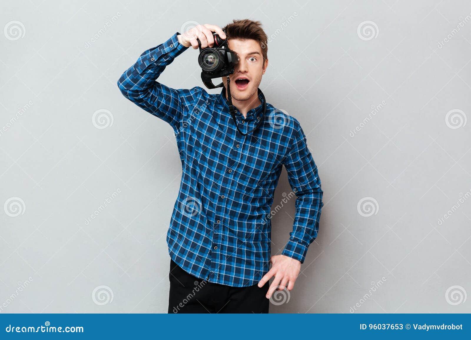 Удивленная деятельность фотографа