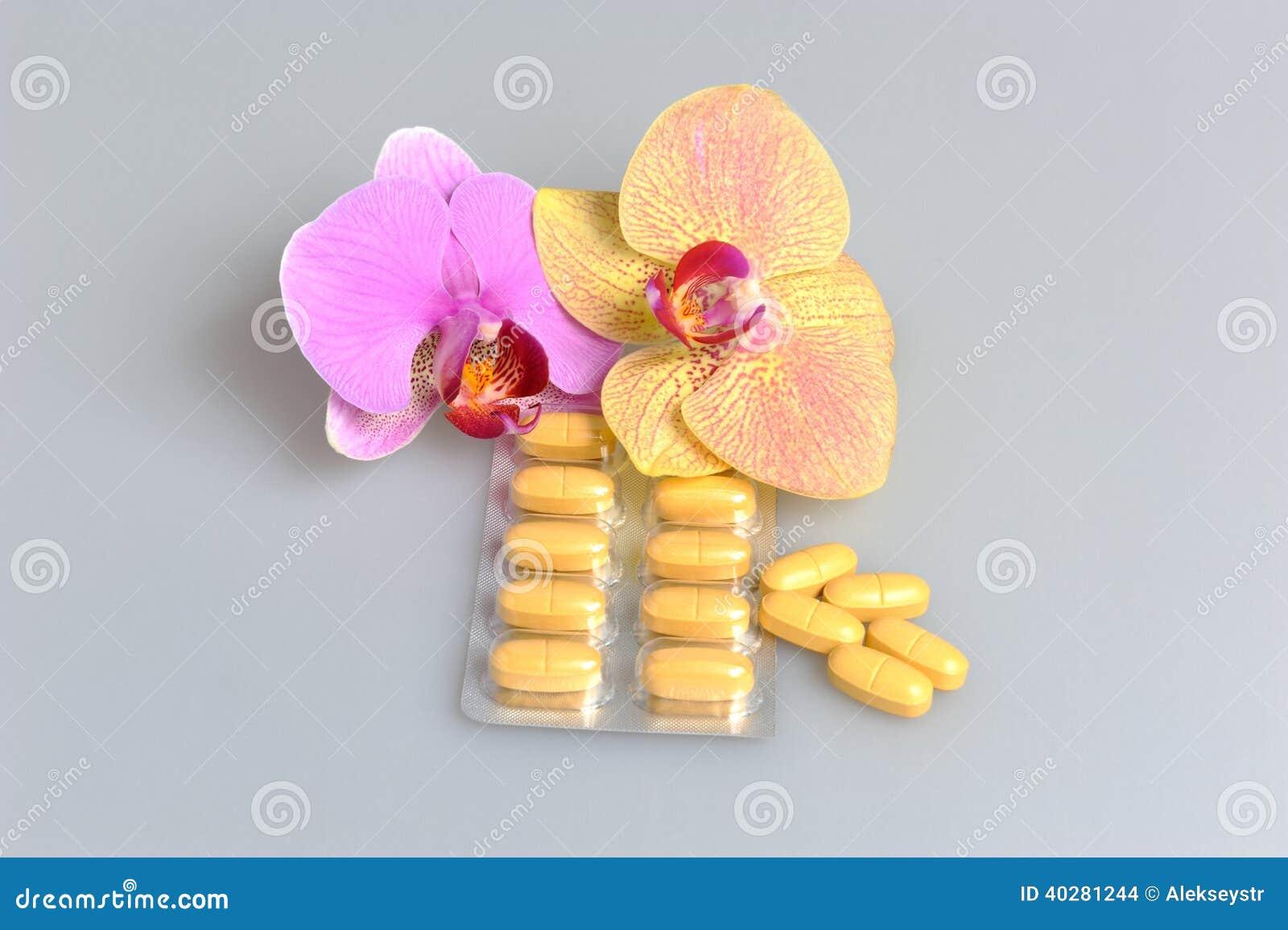 Фильм-покрытые таблетки с 2 цветками орхидеи на сером цвете