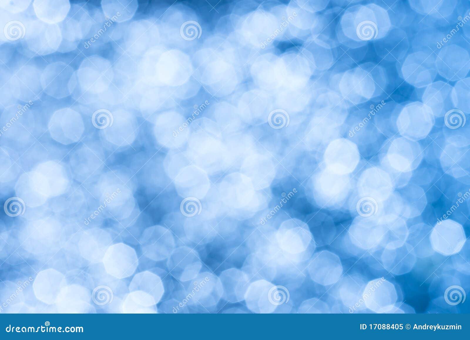 фокус bokeh абстрактной предпосылки голубой