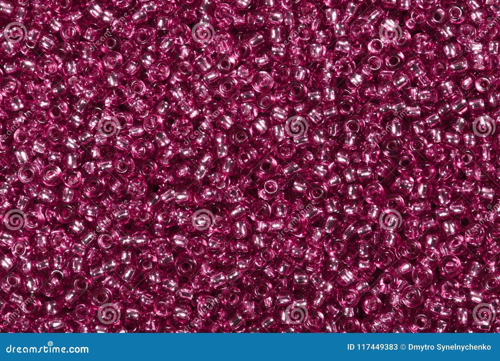 Фон с крошечным темным розовым стеклянным семенем отбортовывает