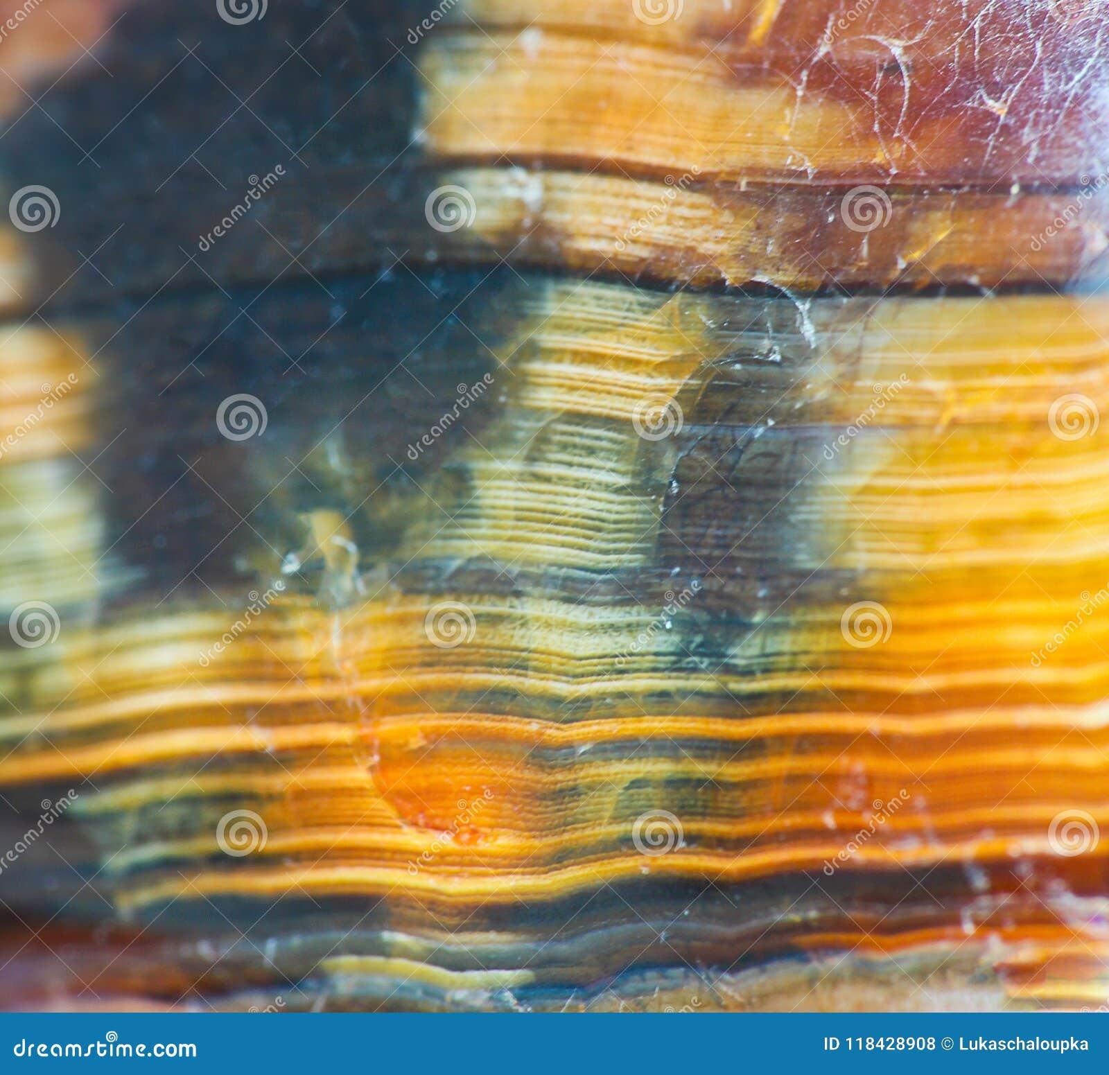 Фото макроса оранжевой каменной текстуры с линиями