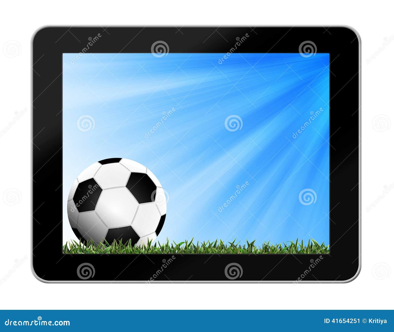 Футбол в зеленой траве с предпосылкой в таблетк-ПК