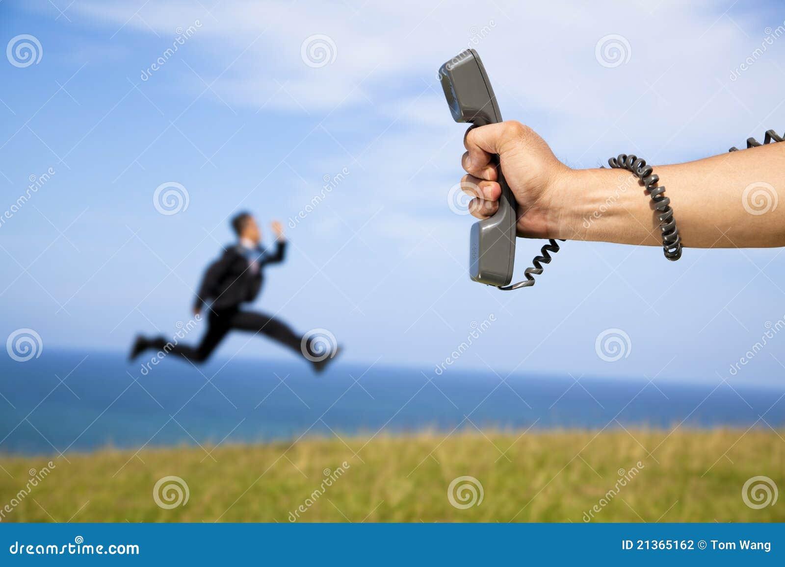 ход телефона удерживания бизнесмена