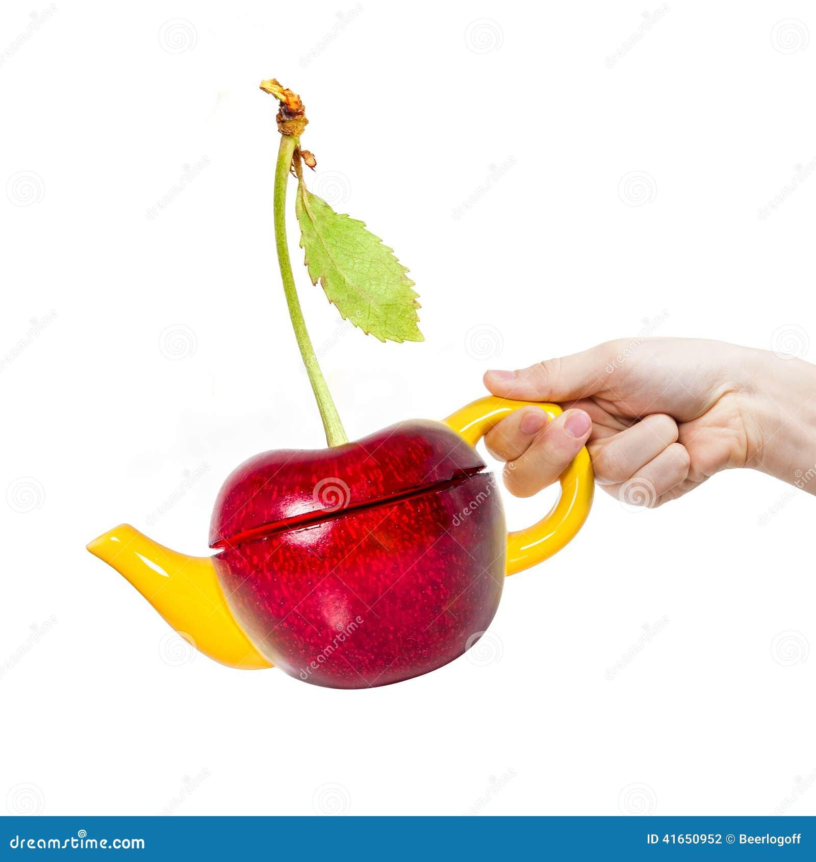 Чайник вишни концепции в руке