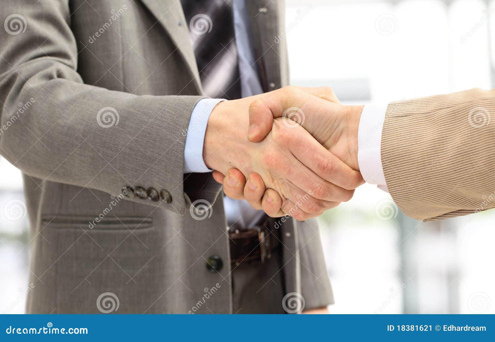 человек рукопожатия дела
