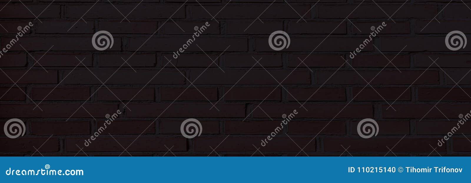 Черная кирпичная стена, темная предпосылка для дизайна Часть кирпичной стены покрашенной чернотой пусто