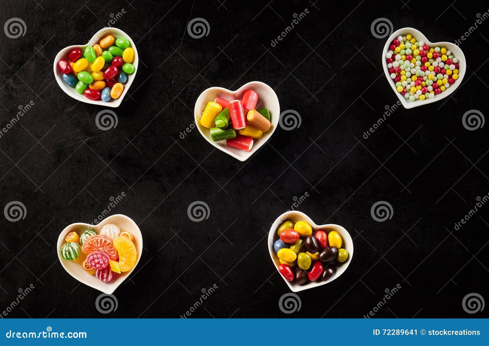 Download Черная предпосылка поставленная точки керамическими шарами Стоковое Изображение - изображение насчитывающей jellybeans, цветасто: 72289641