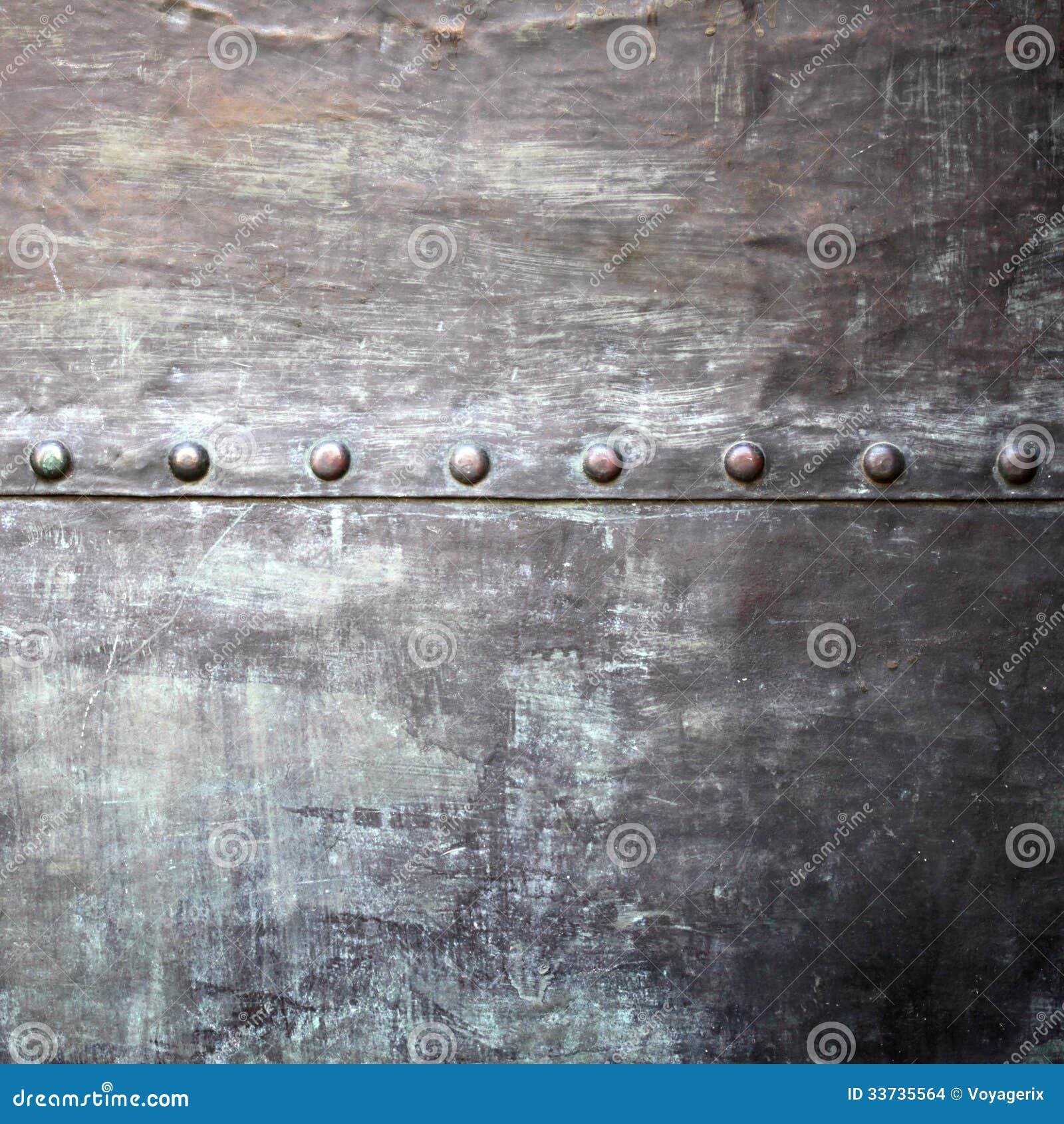 Черная текстура металлической пластины или панцыря с заклепками