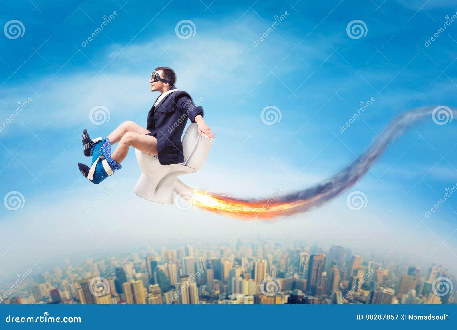 Человек в пилотных стеклах летая на шар туалета двигателя