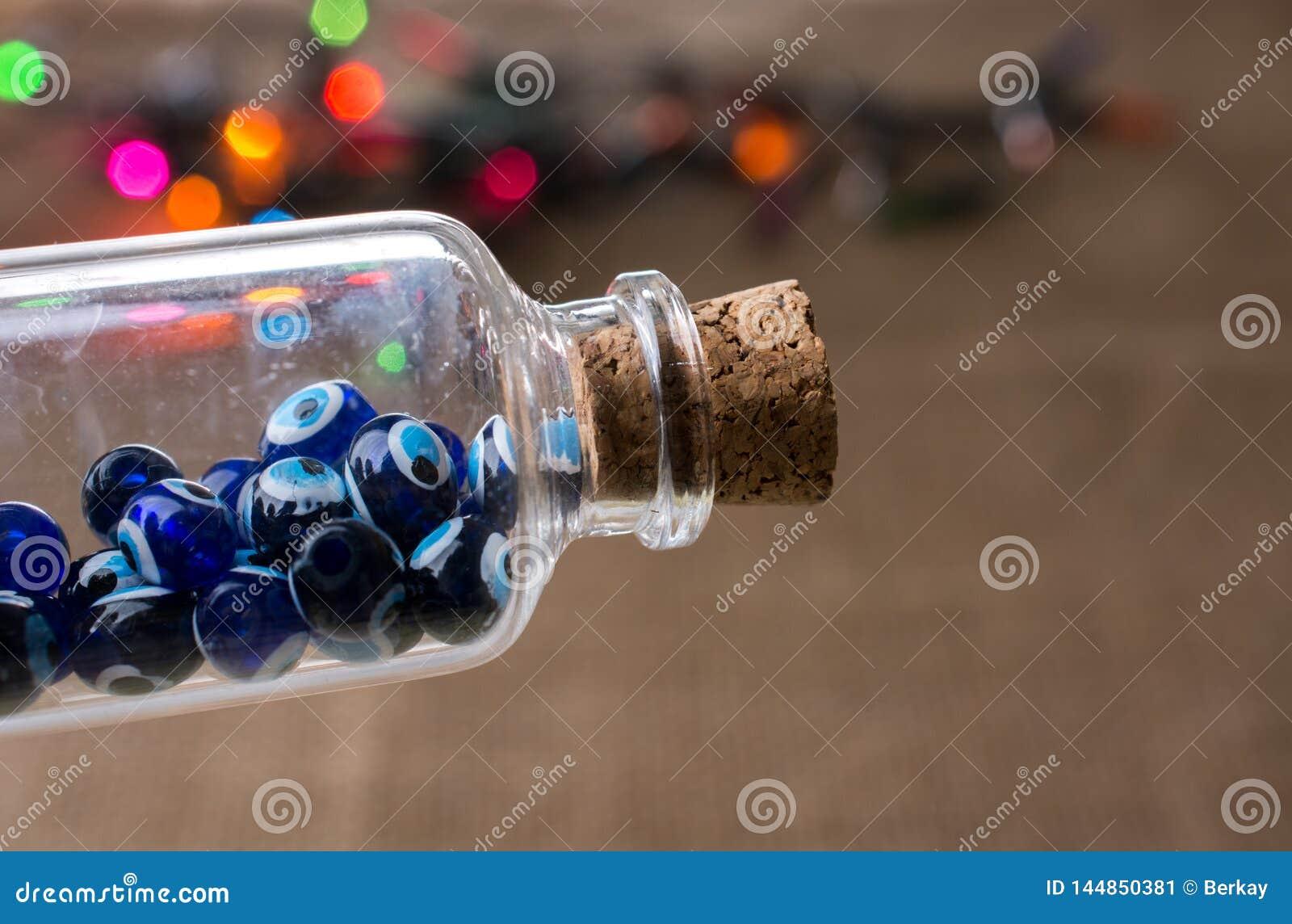 Шарик дурного глаза в бутылке как сувенир