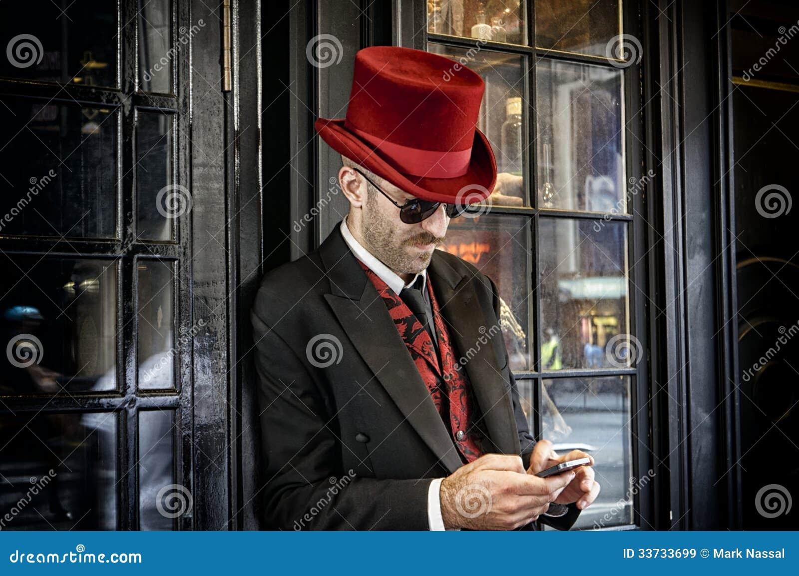 Швейцар в шляпе красного верха