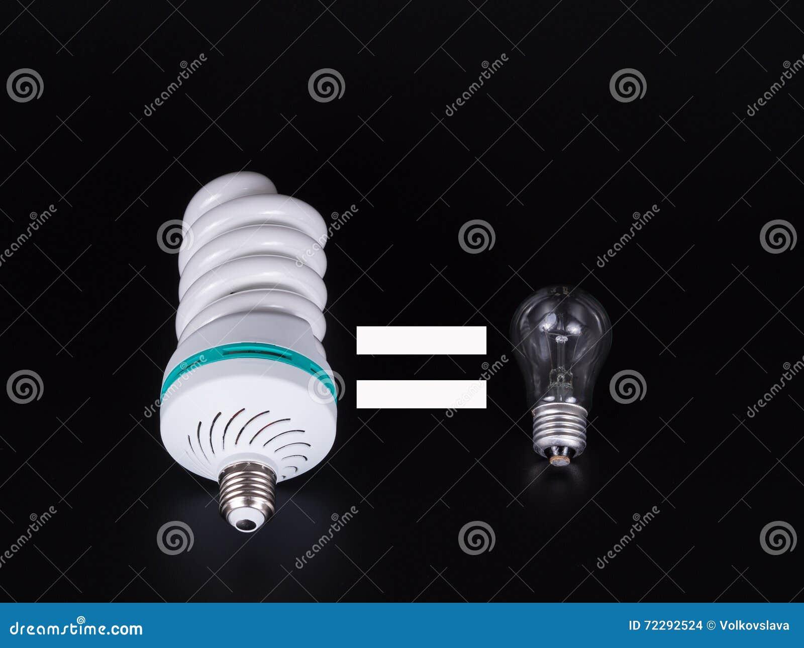 Download Энергосберегающая изолированная лампа на черноте Стоковое Фото - изображение насчитывающей консервация, компакт: 72292524