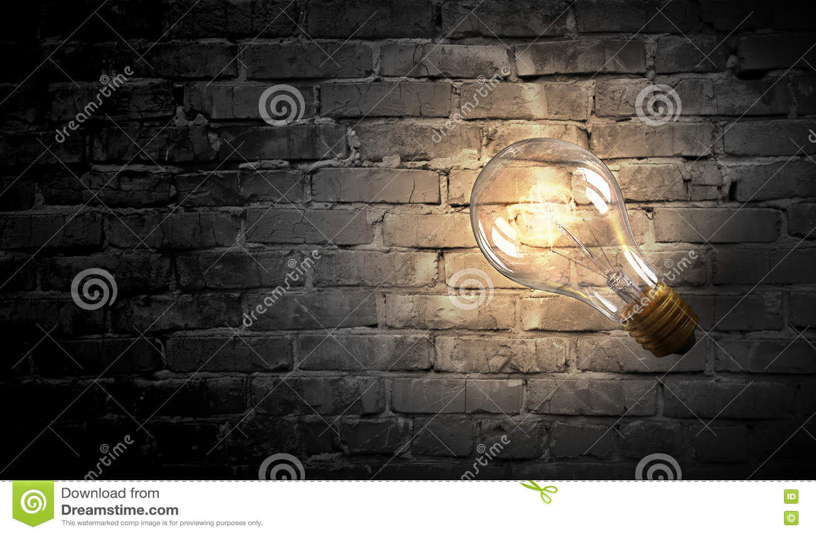 Электрическая лампочка на поверхности кирпича Мультимедиа