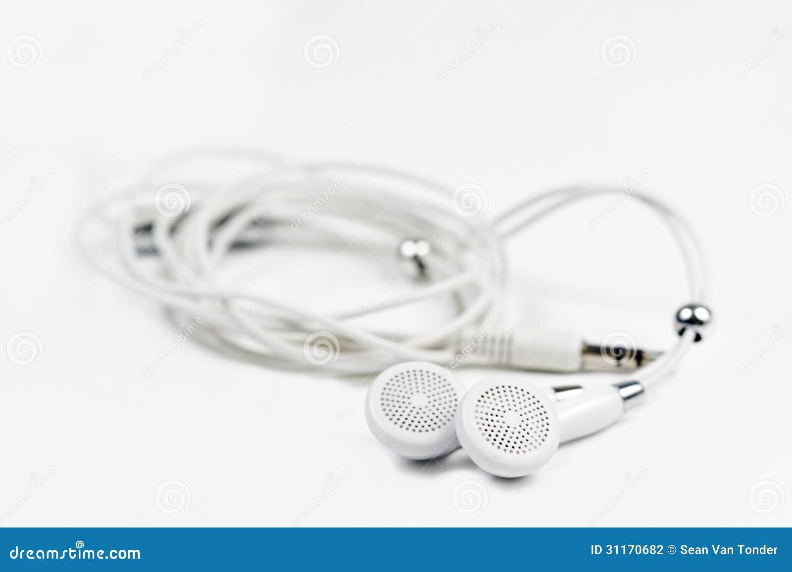 在白色背景的小耳机 图库摄影