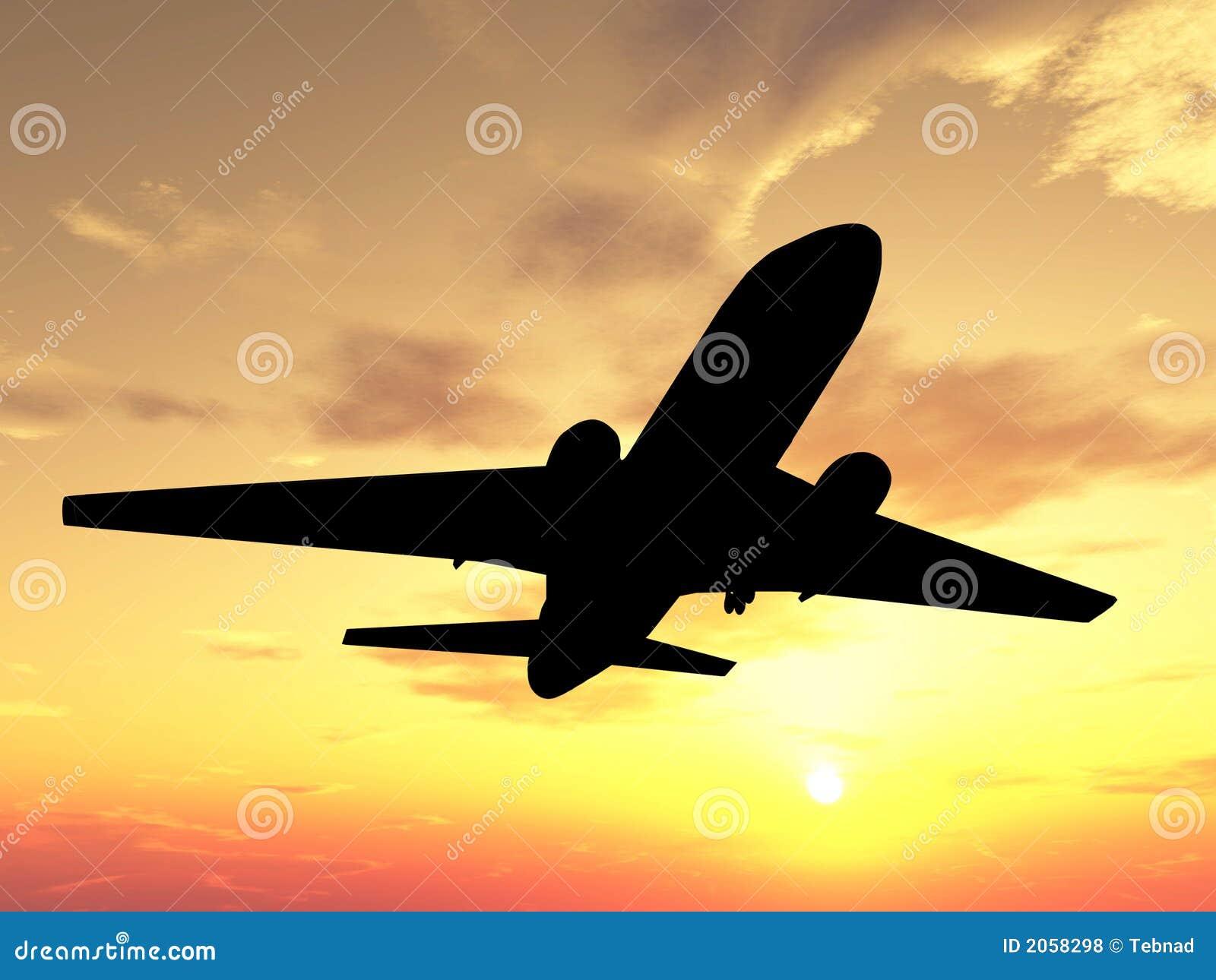 在剪影日落的飞机