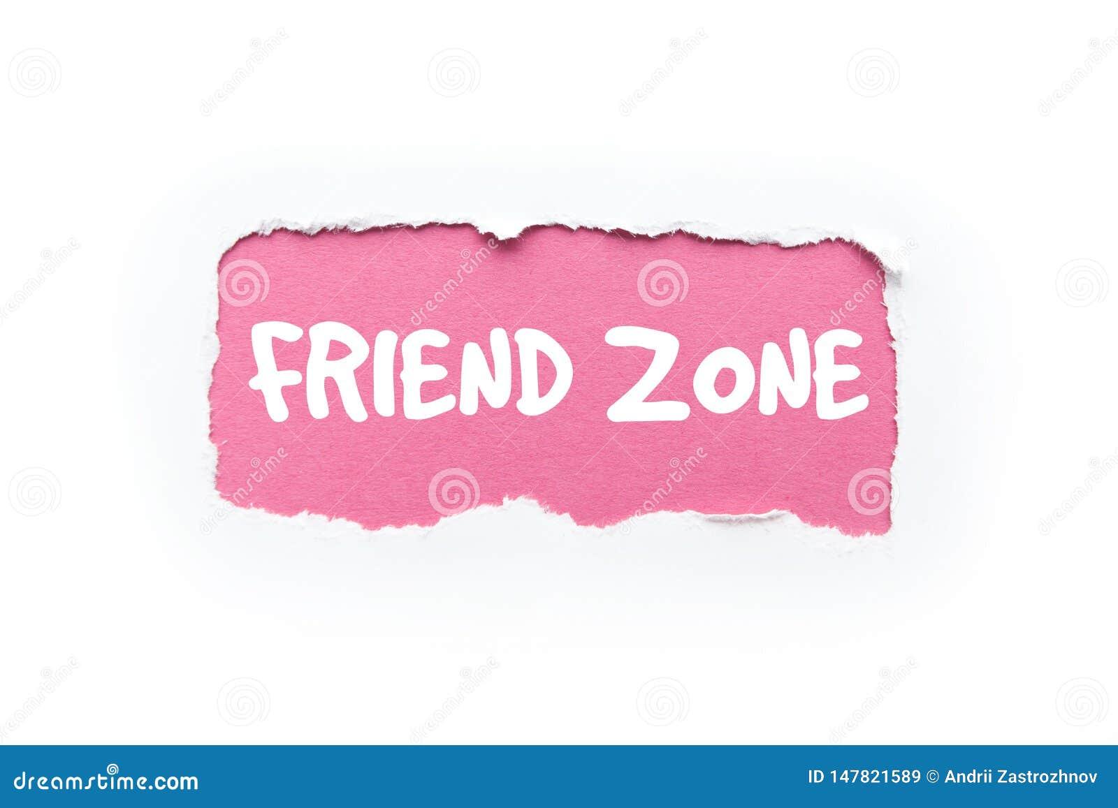'Uma zona do amigo 'em um fundo branco e cor-de-rosa rasgado