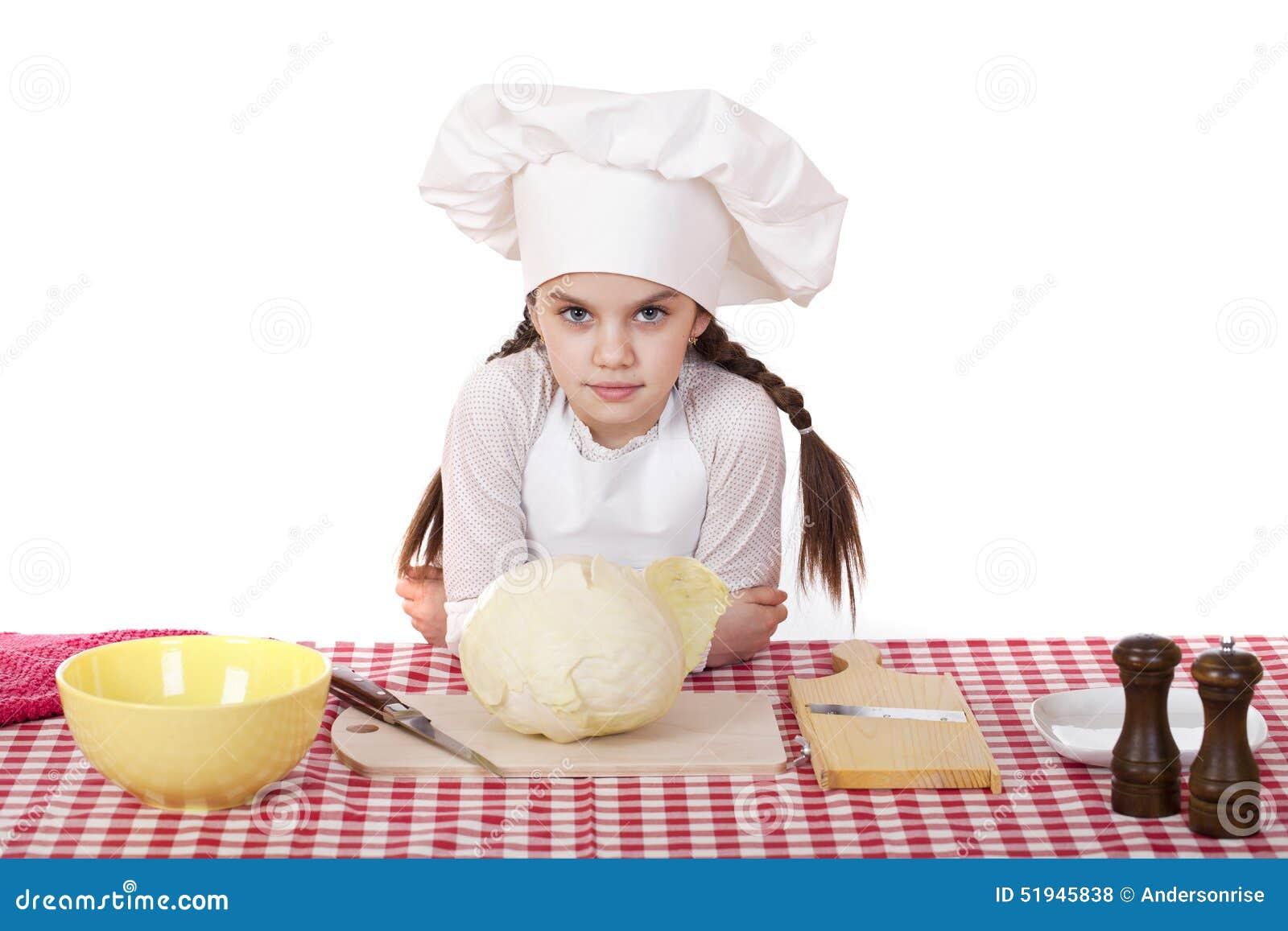 一个小女孩的画象一块白色围裙和厨师帽子细片的c图片