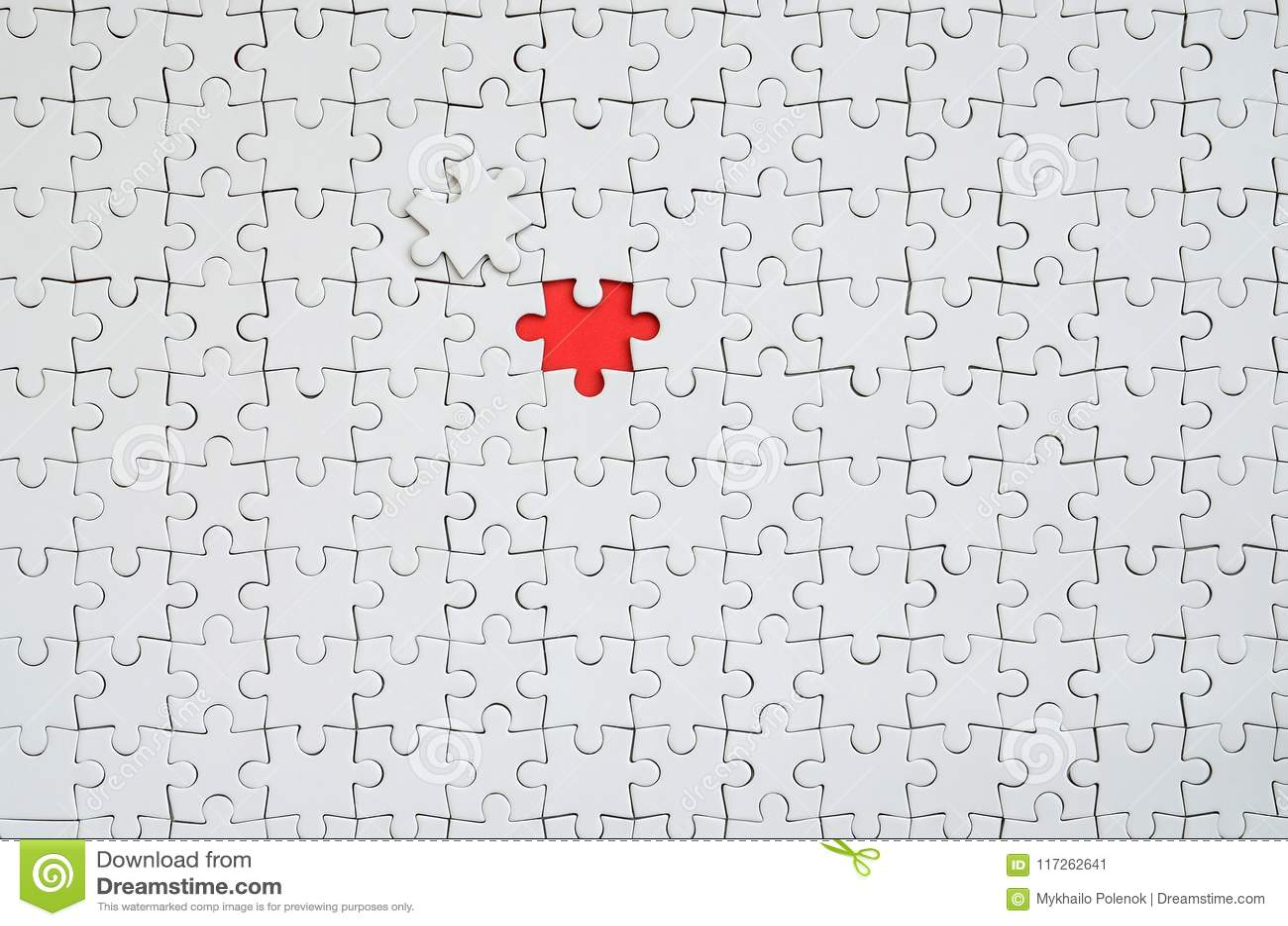 一个白色七巧板的纹理在一个被装配的状态的与形成红色空间的一个缺掉元素