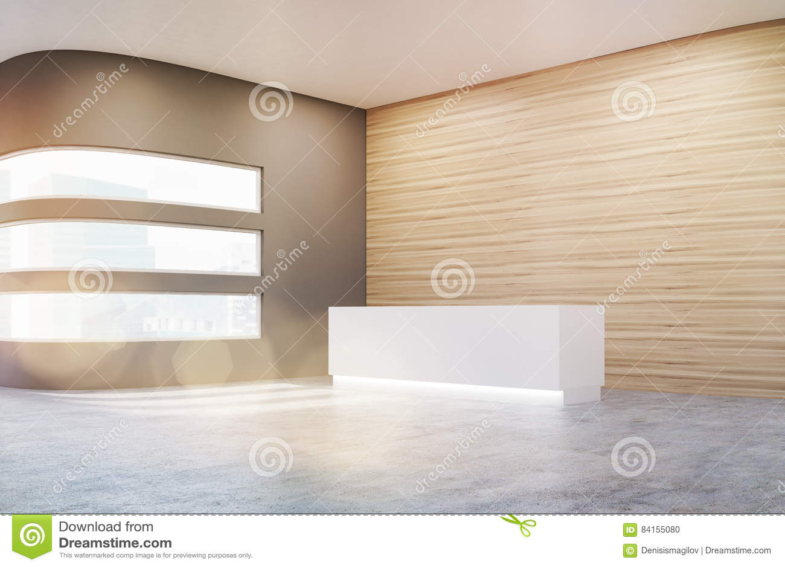 一个空的办公室大厅的侧视图有木和灰色墙壁和水泥地板的