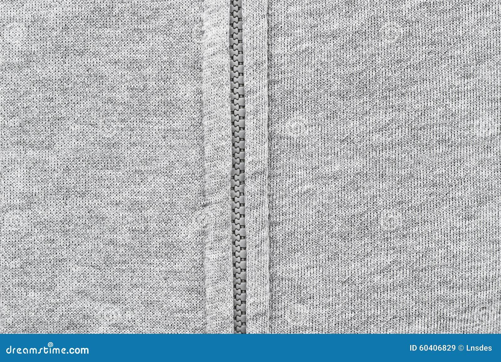 一部分的有拉链的灰色衣裳