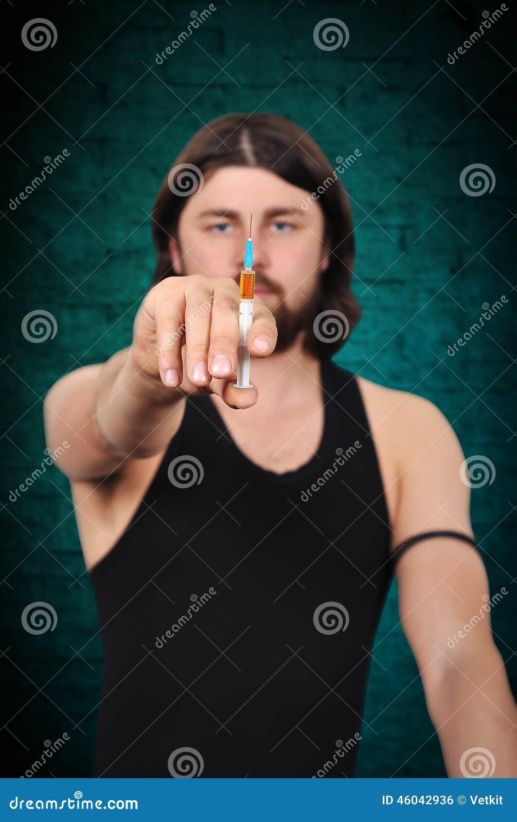 上瘾者药物射击被模拟的工作室注射器