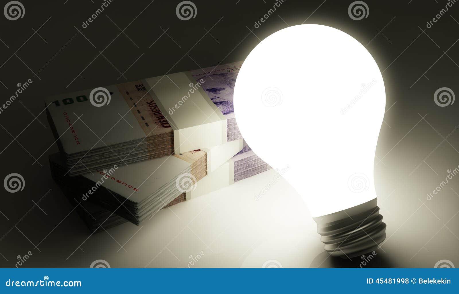 与发光的电灯泡的阿根廷比索堆