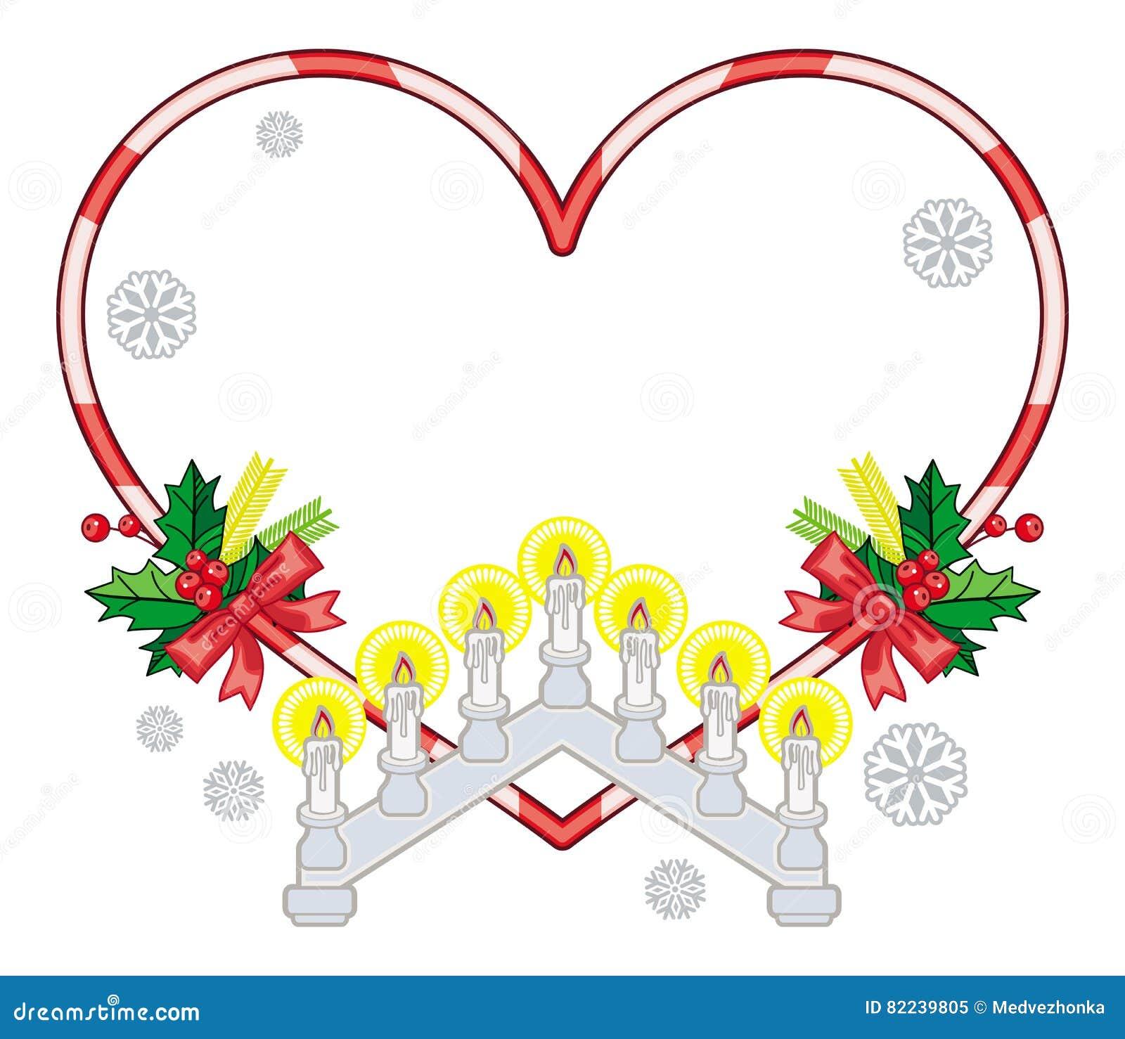 与圣诞节装饰的心形的框架和轻的蜡烛成拱形