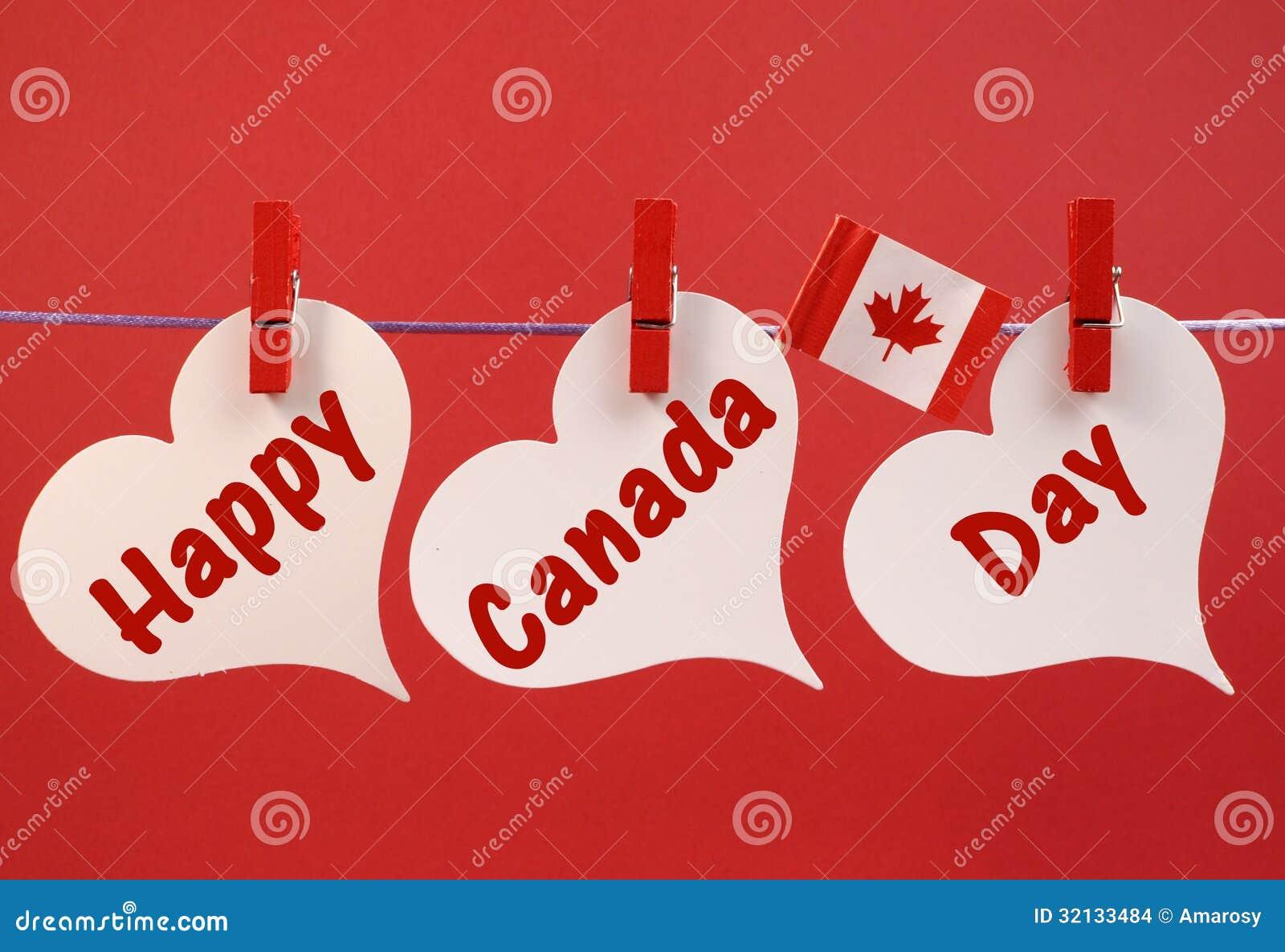 与垂悬从在线的钉的加拿大枫叶旗子的愉快的加拿大日消息问候