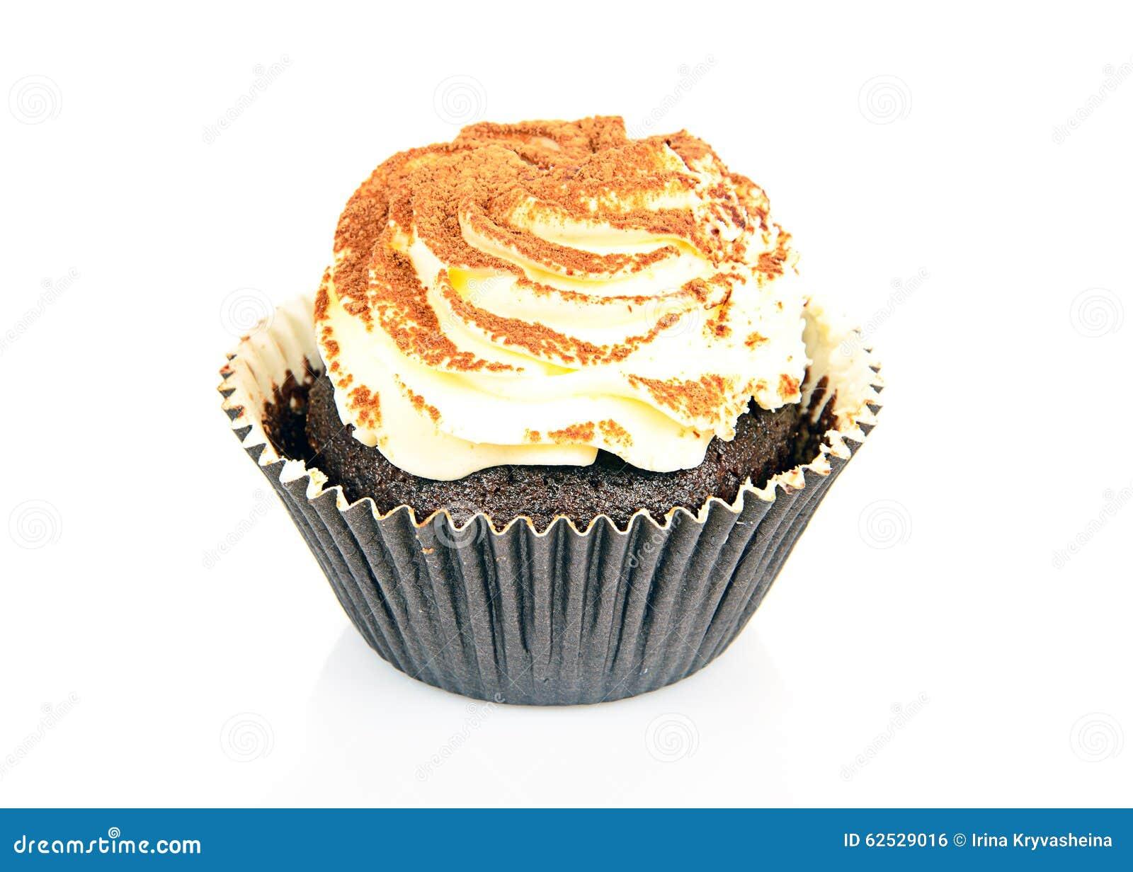 与奶油,在白色的杯形蛋糕的蛋糕