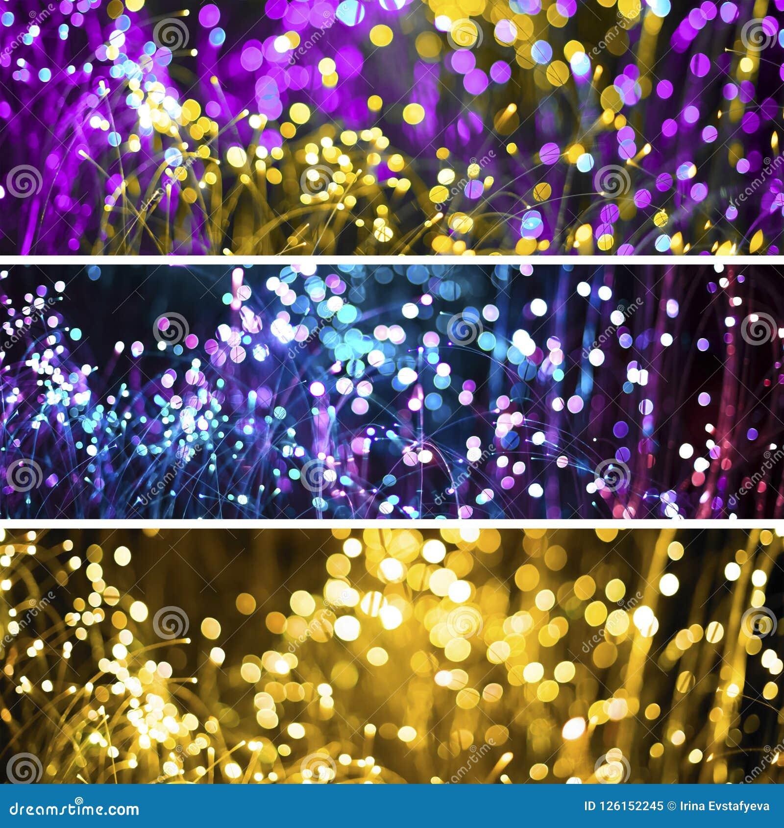 与幻想bokeh纹理紫色氖的抽象背景和金黄 时兴的套三圣诞节背景