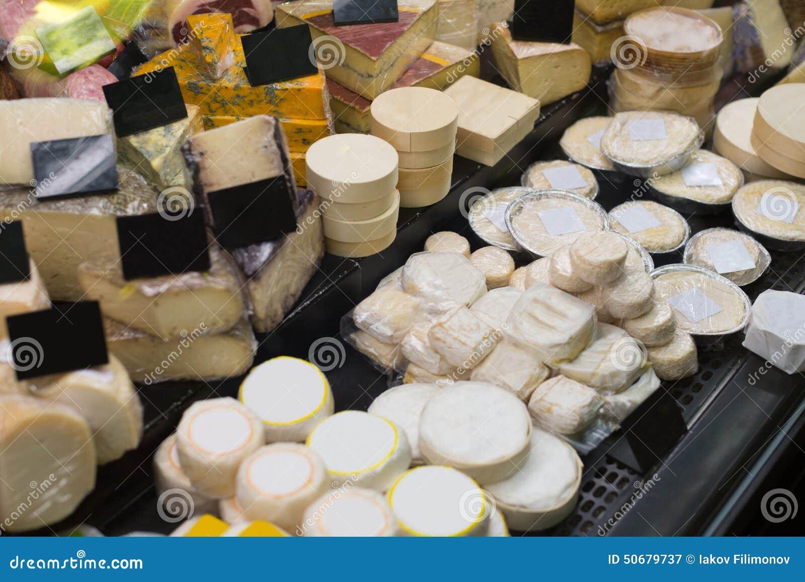 Download 与新鲜的干酪种类的市场柜台 库存图片. 图片 包括有 艺术家, 美食, 点心, 题头, 室内, 许多, 苹果酱 - 50679737
