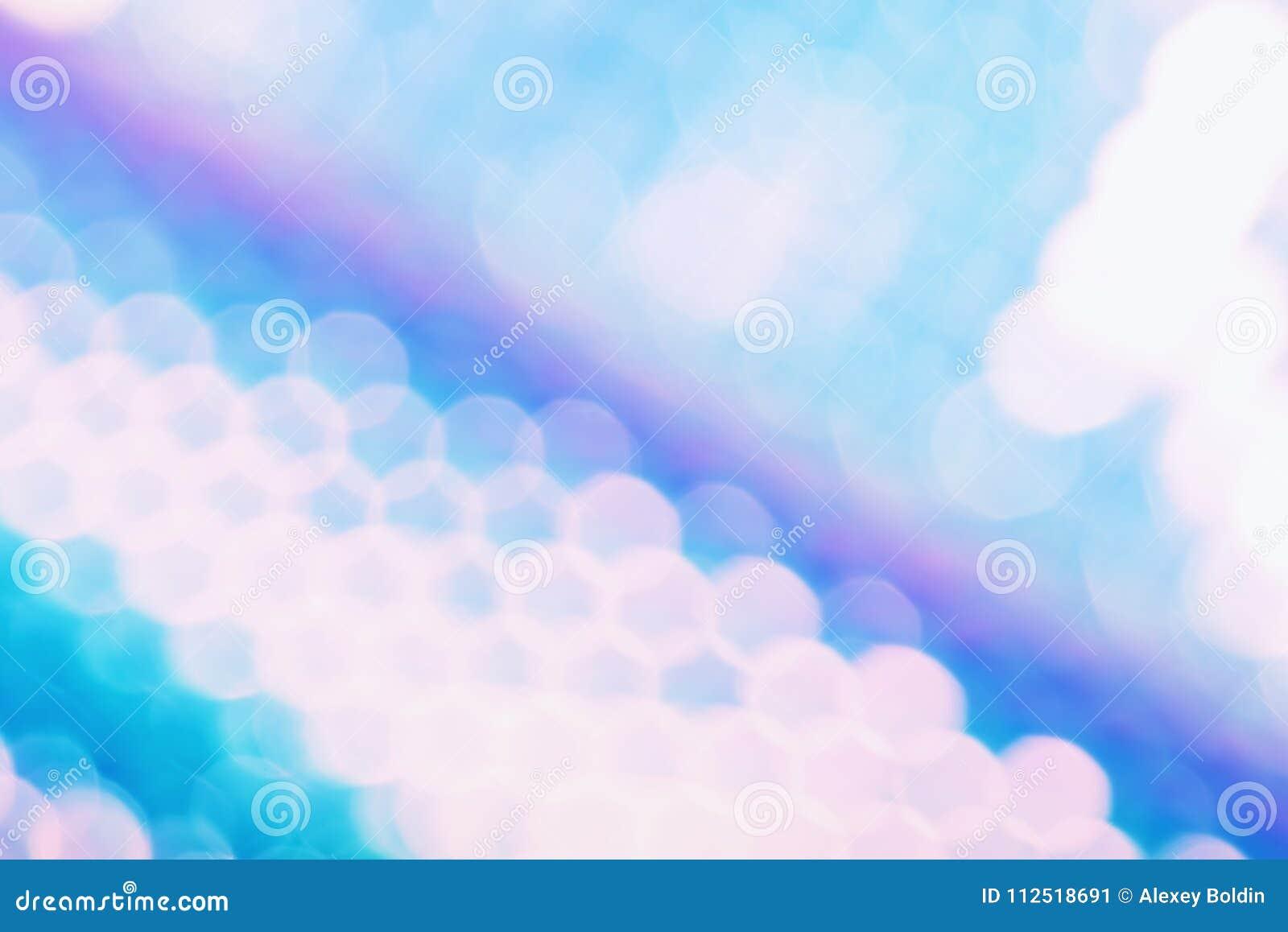 与时髦holo颜色样式和闪耀的bokeh光线影响的全息照相的箔背景